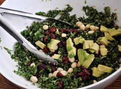 kale salad with quinoa, dried cranberries, macadamia nuts and avocado