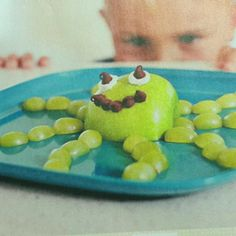 Cute snack for kids! Half an apple, halved grapes, chocolate chips, and fruit dip! :)