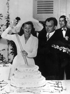 Dancer and film actress Rita Hayworth cutting the cake at her 1949 wedding to Prince Aly Khan, a son of Sultan Mahommed Shah, Aga Khan III, the leader of the Ismaili sect of Shia Islam. They had one child and divorced in 1953.  Her other husbands included Edward C. Judson, Orson Welles, Dick Haymes, and James Hill.