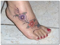 orchid tattoos on foot | Orchid Flower Tattoos and Tattoo Designs Pictures Gallery