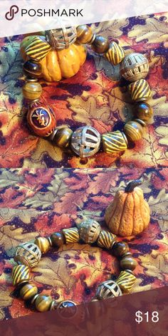 Fall colored bracelet This falling leaves colored bracelet is made with tigers eye, West African krobo beads and brass. Larger size. Can be worn by your man! 😉 Jewelry Bracelets