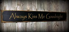 Always Kiss Me Goodnight Handcrafted wooden sign.