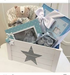 Basket for future diaper changes filled with picture frames and albums