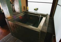 How cool is this square bathtub from Bath Inspirations?