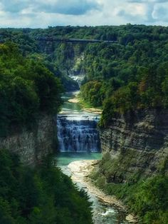 Letchworth State Park, with some of the most magnificent scenery in the United States, comprises 14,350 acres along the Genesee River. Within the park, the river roars over three major waterfalls, one of which is 107 feet high. The cliffs, created by the river's path over thousands of years, approach 600 feet.  A multi-faceted park, Letchworth offers opportunities for a wide variety of interests. Millions of years of geological history can be observed in the rock formations exposed by ero...