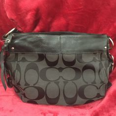 """Authentic Coach grey and black chain link purse 100% Authentic!!! Money back guarantee   Creed #: j0993-f12657  Coach signature fabric with leather trim and accents.Silver tone Hardware.Zip Top Closure.Coach leather hangtag.Has key. One back zip pocket. Interior:2 Slip Pocket & 1 Zip Pocket.  Size:14""""Lx11""""Hx4""""D.  Strap drop:8 ✨✨NEW✨NEVER USED✨DUST BAG INCLUDED Coach Bags"""