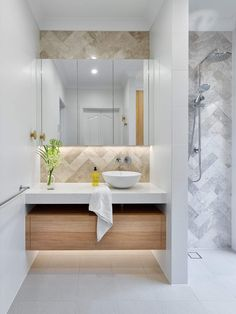 Showcasing our silver travertine in a recent bathroom renovation by Brilliant SA. Silver travertine's beauty lies in its unique colour, toning and textural variation. Display this unique tile in a herringbone pattern is a great option for creating a stron Bathroom Tile Designs, Bathroom Layout, Bathroom Wall Decor, Bathroom Interior, Laundry In Bathroom, Small Bathroom, Travertine Bathroom, Marble Bathrooms, Diy Home