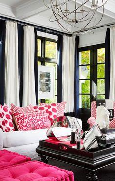 Living Room with glossy black walls and pink ikat by interior designer Megan Winters, via @sarahsarna.