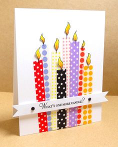 Card for Gallery Idol Auditions - Trim washi tape into long strips, using poka dots as a guide.  - Add strips to card base - Hand drew the candle frames, color and cut out. Adhere to each washi tape candle - Die cut banner, stamp sentiment add rhinestones, Adhere to card with foam tape  For the details and supplies see my blog:http://kraftpaperstamps.blogspot.com/2014/05/one-more-candle.html