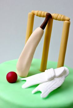 Cricket Bat and Ball cake covered in fondant, decorated ...