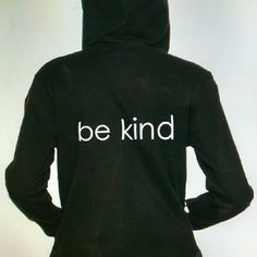 """Be Kind"" Long Sleeve Hoodie A black hoodie w/long sleeves, thumb hole. Hood is lined. Mid weight hoodie excellently made. Throw over a swim suit as the sun goes down or take to a game when the wind picks up. ""Be Kind"" across the back is  screen printed on, a positive enforcement to pass on to others. A red stitched heart on left upper arm. In error I listed a size L I was going to keep but sadly it got sold.  100% Cotton Machine wash and dry. Turn inside out when washing.  Pit to pit 20.5""…"