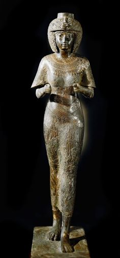 Statue of Karomama Meritmut, the Divine Adoratrice of Amun (bronze with gold, silver and electrum, height: 59 cms). Third Intermediate Period, 22nd Dynasty, ca. 850 BC. Now in the Louvre.