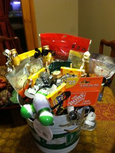 Birthday basket for men! Made this for my dad's 60th birthday. Put a gift card, booze, candy, jerky, trail mix. Some of his favorite things.