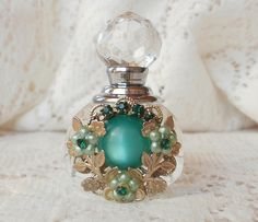 Jewelry embellished perfume bottle