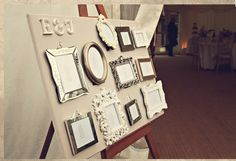 Mismatched picture frames with table details via Junk Shop Bride.
