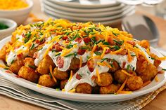 Love loaded baked potatoes? Then these bacon-and-cheddar-topped Totchos are right up your alley. Sour cream spiked with Ranch dressing makes 'em extra yum!