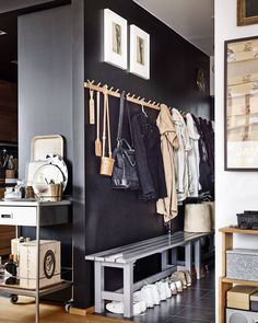 """An Unexpected (& Seemingly Counterintuitive) Foyer Trick to Make Your Home Feel Bigger Entryway inspo: the dark color wall makes the """"true"""" bright interior pop – the coats etc blen Home Design Decor, Home Interior Design, Interior And Exterior, House Design, Modern Interior, Decoration Hall, Entryway Decor, Entryway Closet, Apartment Entryway"""