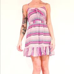 """Pink Striped Ruffle Mini Dress Details: 100% Rayon// Like NEW// Adorable and Comfortable// Elastic around waist, bust, and arms for a bit of stretch// Bust:30""""// Waist:24""""// Hips:44""""// Rise:35""""// Arm Openings: ADJUSTABLE STRAPS Xhilaration Dresses Mini"""