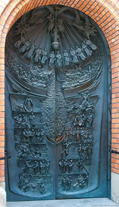 Interesting door to the Cathedral in Tarnow, Poland. Built 1826, reconstruction in late 19th century.  This wonderful door appears to tell the story of the gospels.