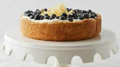 This glorious lemon-blueberry tart, filled with a tangy lemon curd, is topped with whipped creme fraiche and a garnish of candied lemon zest. Martha made this recipe on episode 706 of Martha Bakes.