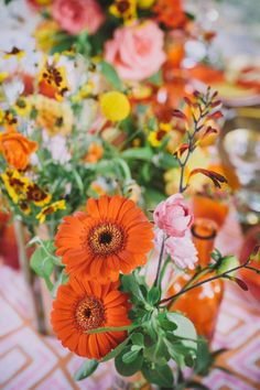 Try gerbera daisies: http://www.stylemepretty.com/2015/04/16/get-the-look-wedding-flower-alternatives/
