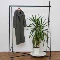 The Geometry clothing rack by Radu Abraham is formed from three shapes: a triangle, a circle and a square