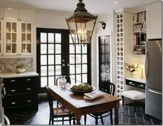 Interior doors painted black with white trim and light walls.  Great idea to add contrast!  So NOT boring!