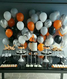 Cool balloon backdrop in grey, orange and marble