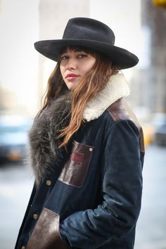 """Beauty Street Stalking: Fashion Week Edition #refinery29  http://www.refinery29.com/2015/02/82619/best-beauty-nyfw-2015-street-style-pictures#slide-22  The hat and the hair say """"California."""" The outfit says """"New York."""""""