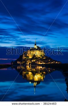 Mont St. Michel reflected in the sea at night