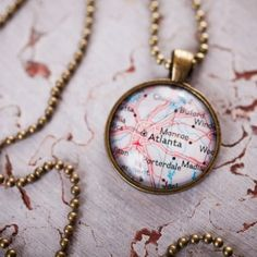 Home Town Map Pendant Necklace from Paper & Place and Bourbon & Boots.  This would make a good gift for Susan,  Someday, she and I are going to travel and this represents our pseudo-sister pact. #BourbonandBoots