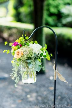 Shepard's Hooks lining the aisle -- such a great idea! :: Olivia Leigh Photographie
