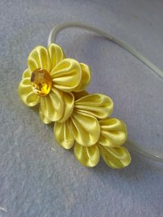 DIY Kanzashi Flower Headband From Ribbon                                                                                                                                                                                 More