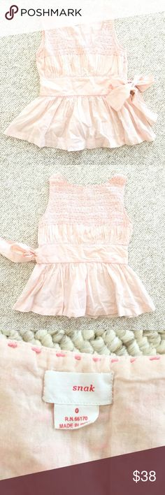 🆕{Listing} Anthropologie Snak Peplum Blouse Peach colored peplum top with pink stitching by Snak for Anthropologie. Zipper at side, sleeveless, bow tie at waist. This top has such beautiful detail and sweet stitches. In perfect condition!!! Make me an offer. Anthropologie Tops Blouses