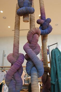 Strung, dyed cardboard circles | probably in anthro