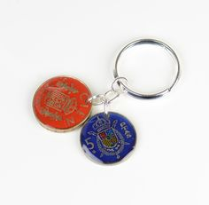 Spain old pesetas coins Keychain. $19.50, via Etsy.
