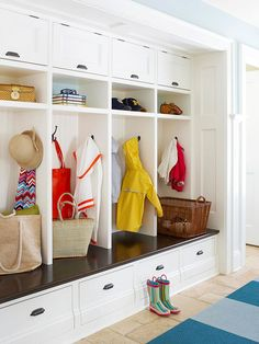 Top-hinged cubbies are easy to access overhead and drawers below help keep the space tidy! .