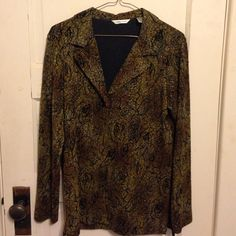 Beautiful Laura Ashley Jacket/Blazer This is a beautiful Laura Ashley blazer/ jacket. It is a size small.  Worn only a handful of times.  Like new! This is light weight, stretchy material. It is 50% acetate, 45% polyester, 5% spandex. The colors are brown, black, and gold.  There is one button in the front.  The pattern in the jacket is roses seen in picture 4.  Open to reasonable offers.  From a smoke free home. No pp or trades.  Thank you for looking! Laura Ashley Jackets & Coats Blazers