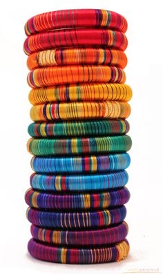 These richly colored, thick bracelets are made from tightly wrapped strands of silk. Bright, colorful and luxurious to the touch. 2.75
