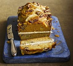 Apples and caramel are a heavenly duo. This nutty sandwich loaf cake with buttercream frosting and caramel drizzle fits the bill nicely