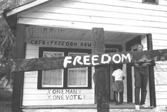 [© Tamio Wakayama] After a cross is burned in front of a freedom house, it becomes a freedom sign. How do we find this photographer? UPDATE: CHECK WITH MATT HERRON AT TAKE STOCK, AS SOME TW PHOTOS ARE THERE... Also in THIS LIGHT OF OURS photo book of Freedom Summer, which I have and which includes an essay by TW