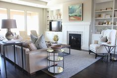 hole-in-one parade home   st. george, utah   by alice lane home collection   great room, living room, bookcase, bookshelves, fireplace, built-ins, leather sofa