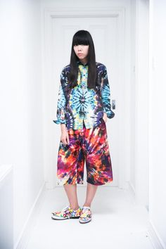 Susie Bubble in Junya Watanabe shirt and Craig Green shorts and Comme des Garcons shoe covers