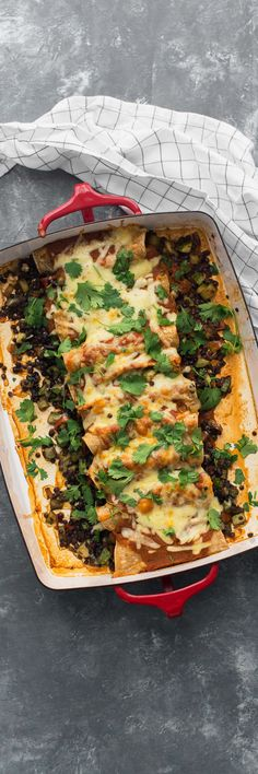 Delicious vegetarian enchiladas filled with zucchini, red peppers, and black lentils then topped with an easy chipotle tomato sauce. #vegetarianrecipe #lentilrecipe #summervegetarian