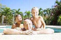 Playing in the pool with grandad is more relaxing when you have a letter of permission to travel. - Photo © Chris Fertnig / Getty Images