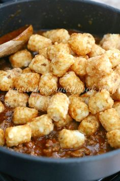 Tater Tot Enchilada Bake recipe from The Country Cook. Tater tots, fajita seasoning, enchilada sauce, ground beef, family favorites, country, southern cooking, dinner