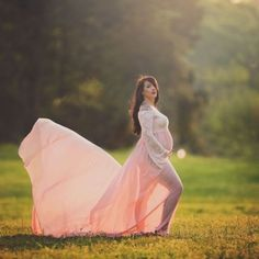 A peach chiffon and lace maternity gown with loose long sleeves that are worn off or just on the shoulder in a ballerina neckline style. The chiffon train is extra long, perfect for tossing or pooling around you for a … read Maternity Gowns, Ballerina, Chiffon, Peach, Neckline, Wedding Dresses, Sweet, Long Sleeve, Style