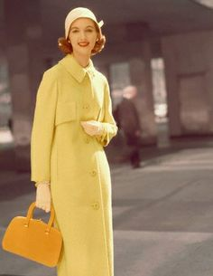 1950  Model is wearing a yellow wool coat by Swansdown and a cloche by John Frederics