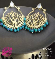 Beautiful chandbali made of setrling silver dipped in gold and finished with tiny turquoise pearls.The floral fligree work at the center makes it an apt statement jewellery for monsoon! Shop now at http://pookaari.com/jewellery/deepa-sethi-jewellery/dream.html Call us on +918489769723