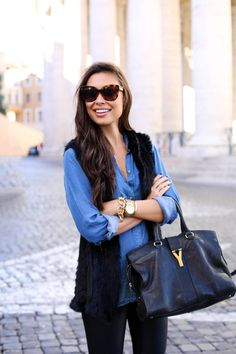 Kat Tanita of With Love From Kat wears leather leggings, a chambray shirt, YSL Cabas Chyc bag, and Aquazzura Marilyn leopard pumps in Rome.
